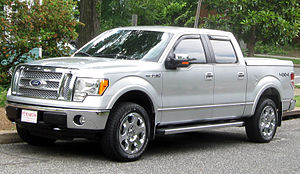 Pickup truck - Ford F-150 Supercrew with tonneau, 4 doors, sideboards, and wind deflectors.