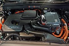 Hybrid 2 0l Gasoline Ed Engine Left And Inverter System Controller On Top Of The Ac Electric Motor