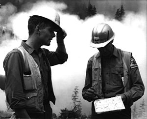 Outline of forestry - Two USFS foresters discussing firefighting tactics.