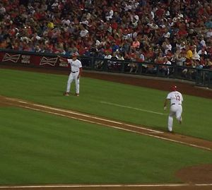 Wally Joyner - Joyner waves Freddy Galvis to second base while serving as first base coach in a Phillies game on September 7, 2013