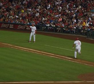 Freddy Galvis - Freddy Galvis runs to first base and Wally Joyner waves him to go to second base in a Phillies game on September 7, 2013