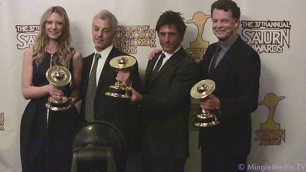 Cast of Fringe holding their 2011 Saturn awards Fringe cast with Saturn awards.jpg