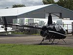 G-GJCD Robinson 22 Helicopter (28717279606).jpg