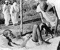 Gandhii looking after Sanskrit scholar Parchure Shastri, who was a leper patient.jpg