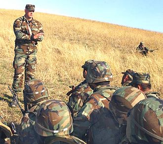 Georgia Train and Equip Program - 10th Special Forces Group soldier instructing Georgian troops on the dangers of conducting live-fire ambushes and maintaining muzzle control.