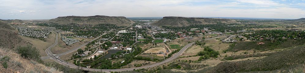 A contemporary panorama of Golden as seen from Mount Zion. In the center is the Coors plant with the North and South Table Mountains to the left and right, respectively. The Jefferson County Courthouse is visible to the far right. The view at the left end is towards the north, the view in the middle is due east, and the view at the right end is towards the south.