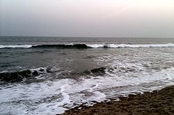 Gopalpur Beach during high tide at sunset