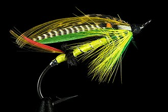 Angling - Green Highlander, an artificial fly used for salmon fishing.