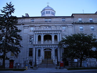 Regiopolis-Notre Dame Catholic Secondary School - In 1892, William Newlands Jr. (architect) converted Regiopolis' five story stone building on Sydenham Street, Kingston, Ontario as the new location of Hotel Dieu Hospital.