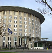 Picture of the building of the OPCW, flying an OPCW flag