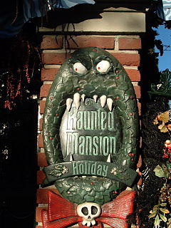 a seasonal overlay of the Haunted Mansion attraction at Disneyland and Tokyo Disneyland