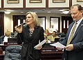 Heather Fitzenhagen with Daniel Raulerson at her side offers closing remarks in debate on the House floor.jpg