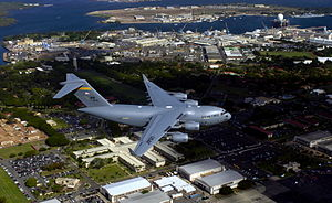 204th Airlift Squadron - 204th Airlift Squadron Boeing C-17 Globemaster III, Hawaii Air National Guard fies over Hickam Air Force Base and nearby Pearl Harbor for the arrival ceremony of its first aircraft. Hickam was the first base outside the continental U.S. to permanently host the C-17