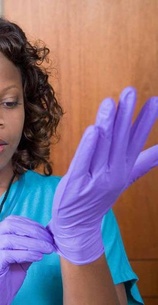 File:Hospital worker putting on sterile gloves.tiff