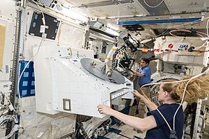 NanoRacks - JAXA astronaut Takuya Onishi (background) and NASA astronaut Kate Rubins (foreground) prepare the NanoRacks External Platform (NREP) for installation.