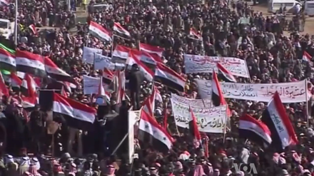 2012-13 Iraqi protests: Iraqi Sunni demonstrators protesting against the Shia-led government. Some Sunnis took up arms and joined forces with ISIL to conduct a military campaign against the Maliki government Iraq Sunni Protests 2013 7.png
