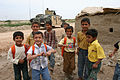 Iraqi children greet Soldiers DVIDS22855.jpg