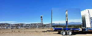 Ivanpah Solar Power Facility - Power tower 2 of the Ivanpah Solar Electric Generating System under construction. The heliostat mirrors on the truck are awaiting installation