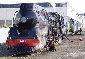 NZR J class (1939) - J 1211 being serviced before departure from Napier. Photo by Joseph Christianson