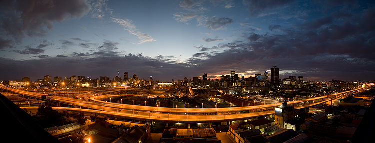 A panorama of the Johannesburg CBD at sunrise looking east across the M1 highway.