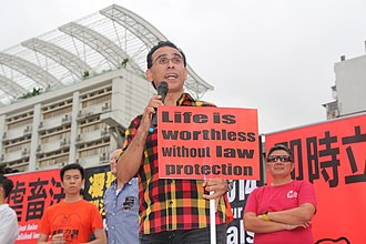 José Pereira Coutinho - José Pereira Coutinho protesting in the streets of Macau in February 2014 against the rejection by the Legislative Assembly of a bill that gives animals basic rights