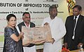 Kavuru Sambasiva Rao distributed improved tool kits of art metalware, woodware to handicrafts artisanscraft persons, at a function, in New Delhi. The Secretary, Ministry of Textile, Smt. Zohra Chatterji is also seen (1).jpg