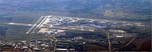Kansas City International Airport - Airport from the east. The overhaul base is in the lower left corner of the field. The proposed Central Terminal would be on the left at the end of the runway.