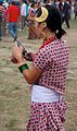 Kirati lady using cellphone wearing traditional costume, Tudhikhel Nepal 2009.jpg