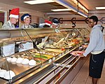 Kirtland leaders serve Thanksgiving meal at Thunderbird 141127-F-KT494-002.jpg