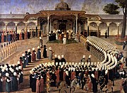 Sultan Selim III holding an audience in front of the Gate of Felicity in the Second Courtyard. Courtiers are assembled in a strict protocol