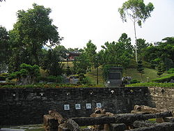 Kowloon Walled City Park, with the remnants of the South Gate in the foreground.