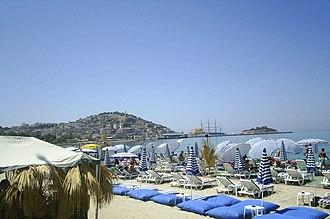 Kuşadası - A beach in Kuşadası, with Güvercinada island seen in the background, at right.