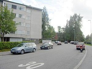 "Kulosaari - View of the ""Svinhufvudintie"" road, exposing some of the low-rise apartment blocks built in the 1960s in Kulosaari"
