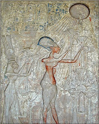 Akhenaten - Pharaoh Akhenaten (center) and his family worshiping the Aten, with characteristic rays seen emanating from the solar disk.