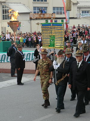National Alpini Association - Members carrying the flag of the association.