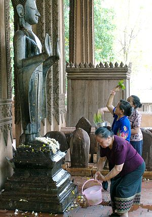Songkran (Lao) - Lao people bathing the Buddha during the New Year