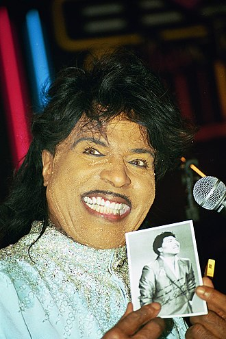 Little Richard - Little Richard holding a photograph of himself at a Best Buddies International event, 1998