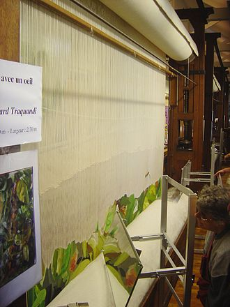 High-warp loom at the Gobelins factory, with mirrors so the weaver, behind the web, can follow his work (photo of low warp loom). Loom haute lisse DSC08774.jpg