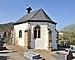 Luxembourg Hostert Niederanven cemetery chapel post.jpg