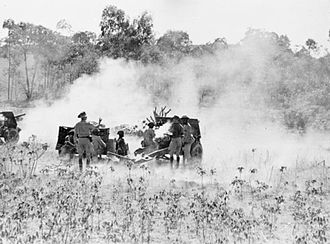 Battle of Madagascar - Kings African Rifles' 25 pdr battery in action near Ambositra in Madagascar against Vichy positions during Operation Steam Line Jane, September 1942.