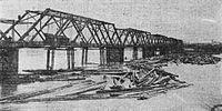 Madison Street Bridge with log jam, March 1908 - Portland, Oregon.jpg