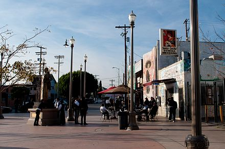 Mariachi bands, who are available for hire, wait at the Mariachi Plaza in Los Angeles Mariachi Plaza (5399467849).jpg