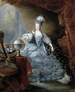 A woman with a pouf wears a voluminous blue dress with a train of fleur-de-lis.