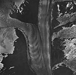 McCarty Glacier, junction of tidewater glacier, hanging glaciers on the surrounding mountains, banded ogives, and icefall (GLACIERS 6617).jpg