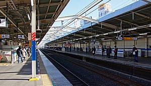 Minami-Koshigaya Station - View of the platforms looking east (toward Nishi-Funabashi) from platform 2 in January 2012