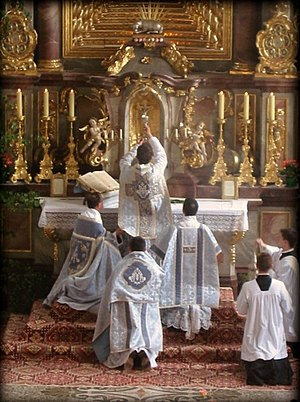 Second Vatican Council - A Catholic priest celebrating Tridentine Mass, the form of the Mass prevalent before the Council, during the elevation of the chalice after the consecration.