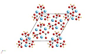Monohydrocalcite - The crystal structure of monohydrocalcite. Ca is shown as a blue atom, O atoms red, and the carbonate anion and water molecules are shown as bonded entities.