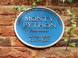 Monty Python - Blue plaque at Neal's Yard, London. In 1976 Palin and Gilliam bought offices here as studios and editing suites for Python films and solo projects.