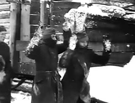 German soldiers surrender: still from the documentary Moscow Strikes Back, 1942 Moscow Strikes Back 27-40 Germans Surrendering.jpg
