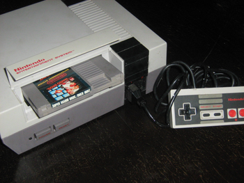 English: A NES console with the Super Mario Br...